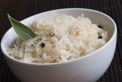 Sauerkraut. Close-up of sauerkraut with black peppercorn and bay leaf in a bowl Royalty Free Stock Photos