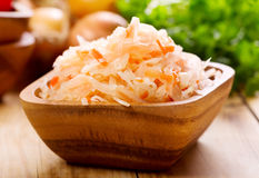 Sauerkraut in a bowl. On wooden table Stock Image