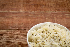Sauerkraut with caraway seeds. A small bowl on a rustic barn wood table Royalty Free Stock Photos