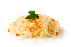 Sauerkraut with carrot and sprig of parsley on a white, closeup. Sauerkraut with carrot and sprig of parsley on a white background, closeup royalty free stock photos