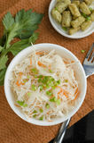 Sauerkraut. With carrot and spring onions and olive oil in bowl Stock Photos