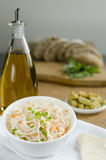 Sauerkraut. With carrot and spring onions and olive oil in bowl Royalty Free Stock Photos