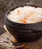 Sauerkraut with carrot. In wooden old table Stock Image