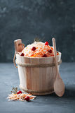 Sauerkraut with carrots and cranberries in  wooden bucket Stock Image
