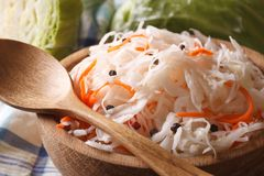 Sauerkraut and carrots in a wooden plate macro horizontal Stock Photography