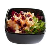 Sauerkraut close in the square salad bowl. Sauerkraut close in the  square black salad bowl.  Isolated on white Stock Images