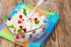Sauerkraut with cranberries  in a glass bowl on a wooden backgro Stock Photography
