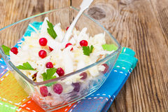 Sauerkraut with cranberries  in a glass bowl on a wooden backgro Royalty Free Stock Photos