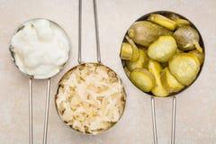 Sauerkraut, cucumber pickles and yogurt Stock Photography