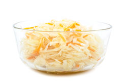 Sauerkraut in a glass bowl. Sauerkraut in a glass bowl isolated on white background Royalty Free Stock Images