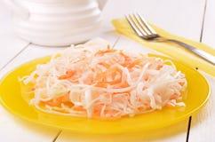 Sauerkraut on glass plate Stock Photography