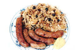 Sauerkraut and grilled sausages Stock Image