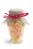Sauerkraut in jar. Sauerkraut in a transparent glass jar on white Royalty Free Stock Image