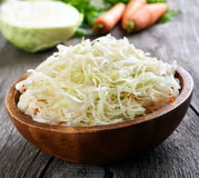 Sauerkraut (marinated cabbage). In wooden bowl, close up view stock photography