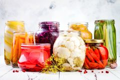 Sauerkraut and marinated pickles variety preserving jars. Homemade red cabbage beetroot, turmeric kraut, Stock Photos