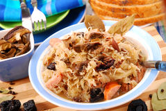 Sauerkraut with mushrooms,plums and sausage Stock Photo