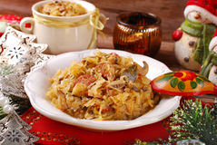 Sauerkraut with mushrooms and sausage for christmas. Plate of traditional bigos (sauerkraut) with mushrooms and sausage for christmas Stock Image