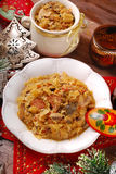Sauerkraut with mushrooms and sausage for christmas. Plate of traditional bigos (sauerkraut) with mushrooms and sausage for christmas-top view Stock Photos