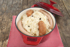 Sauerkraut in red stew pot Stock Photo