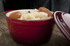 Sauerkraut in red stew pot Stock Photography