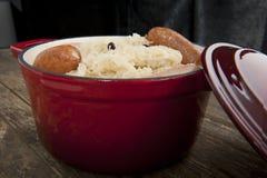 Sauerkraut in red stew pot Stock Photography