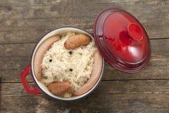Sauerkraut in red stew pot Royalty Free Stock Photos