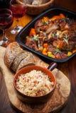 Sauerkraut with roasted pork belly on vegetables Stock Photos