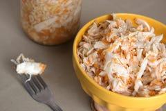 Sauerkraut. Russian traditional sauerkraut. Preparation with cabbage, sugar and salt for winter Stock Image