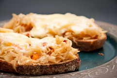 Sauerkraut on rye bread. Chipotle sauerkraut with melted gouda cheese on rye bread. Sauerkraut is known for its health benefits and as a source of good gut Stock Photos