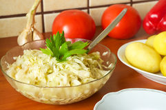 Sauerkraut salad. In the kitchen Royalty Free Stock Photography