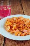 Sauerkraut salad. With paprika, glass of juice on the side Stock Images