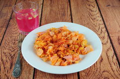 Sauerkraut salad. With paprika, glass of juice on the side Royalty Free Stock Photo