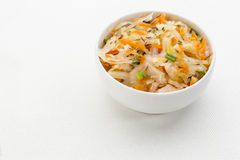 Sauerkraut salad. With carrot, green onion, caraway and olive oil - a small bowl against white canvas Royalty Free Stock Images