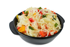 Sauerkraut salad. With pickled vegetables in black earthenware isolated Royalty Free Stock Photos