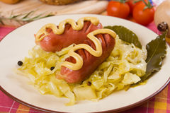 Sauerkraut with sausages, traditional german meal Stock Image