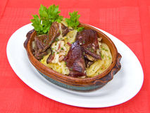 Sauerkraut with smoked meat. In clay bowl Royalty Free Stock Photos