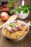 Sauerkraut with smoked meat Stock Images