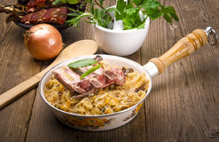Sauerkraut with smoked meat Royalty Free Stock Photos