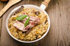 Sauerkraut with smoked meat Royalty Free Stock Photos