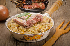 Sauerkraut with smoked meat Stock Image