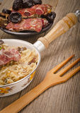 Sauerkraut with smoked meat Royalty Free Stock Photography