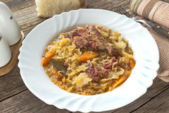 Sauerkraut with smoked pork meat Royalty Free Stock Images