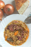 Sauerkraut with smoked pork meat in plate Stock Photos