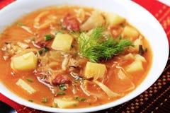 Sauerkraut soup. With potatoes and sausage Stock Photos