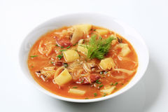 Sauerkraut soup. With potatoes and sausage Royalty Free Stock Photography