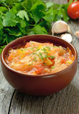 Sauerkraut soup. In brown bowl on wooden table Stock Photography