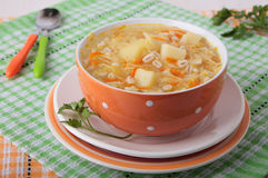 Sauerkraut soup with pearl barley and potatoes Stock Photography