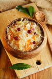 Sauerkraut - Sour cabbage -  on wooden bowl with bay leaves Royalty Free Stock Photo