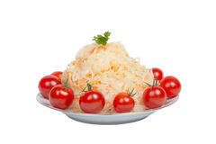Sauerkraut with tomatoes on a plate isolated on white background Royalty Free Stock Photo