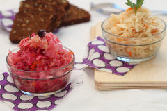 Sauerkraut of two types. With carrots and with carrots, beet and blackcurrant Stock Photo